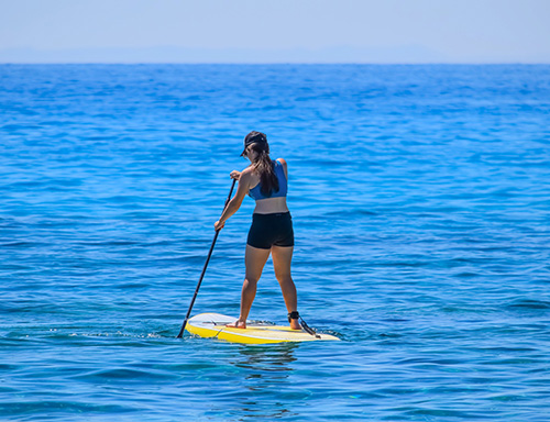 woman paddleboarding alone