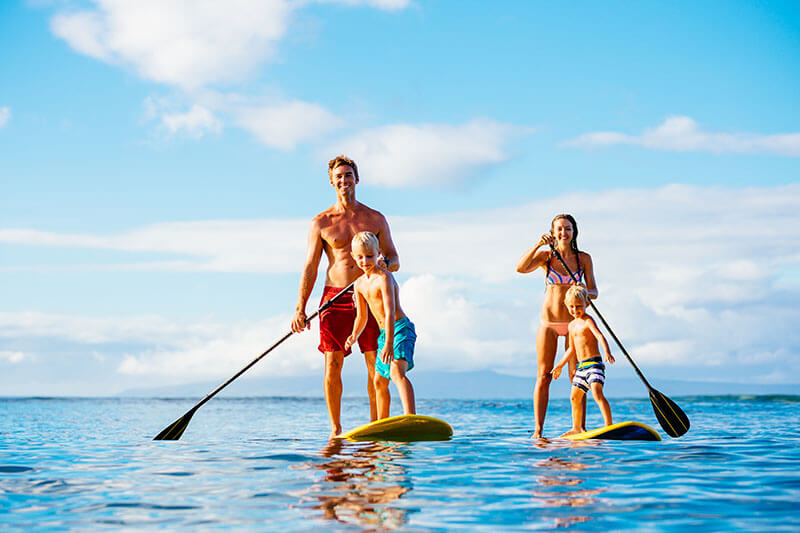 A family paddleboarding