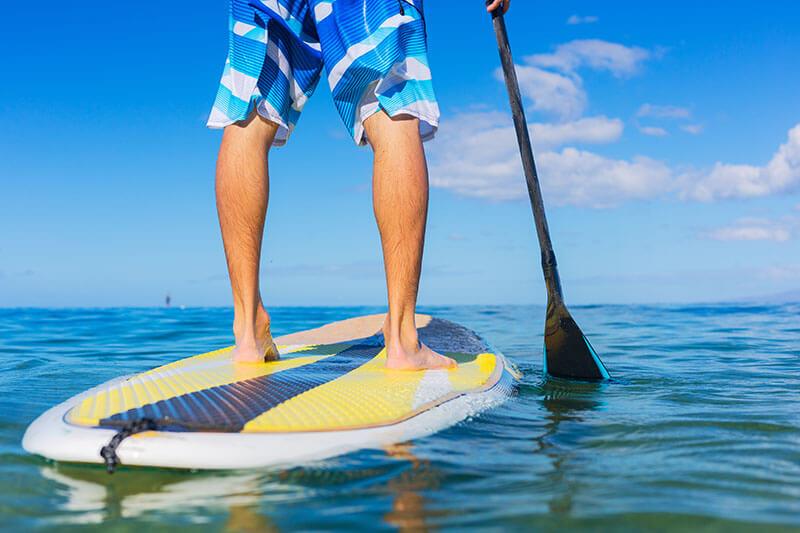 man paddleboarding